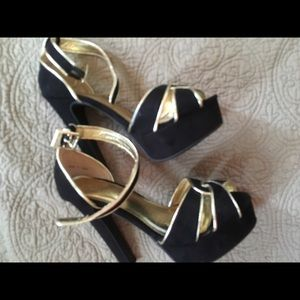 Black and gold pumps , brand new